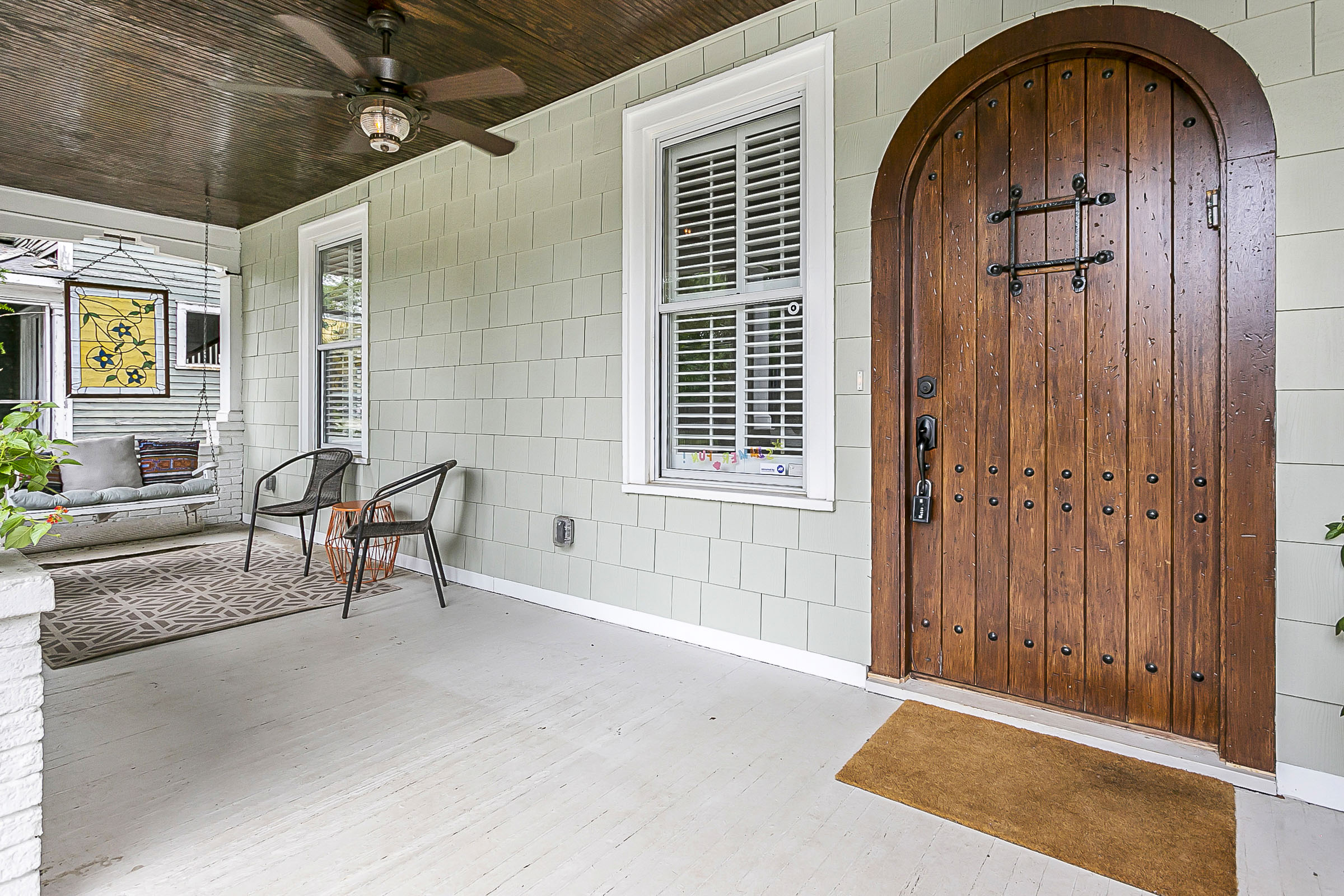 View of Front porch and a beautiful hardwood door.